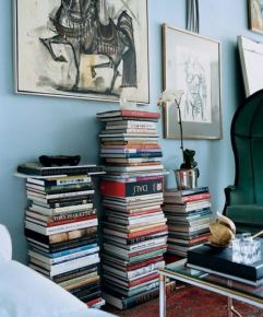 Books Stacked on the Floor
